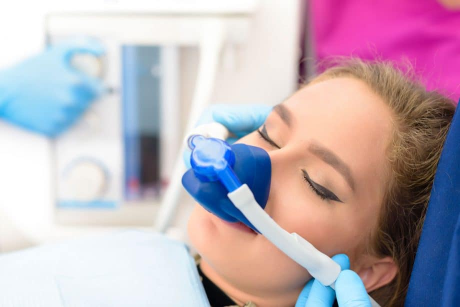 female patient getting sedated for dental procedure